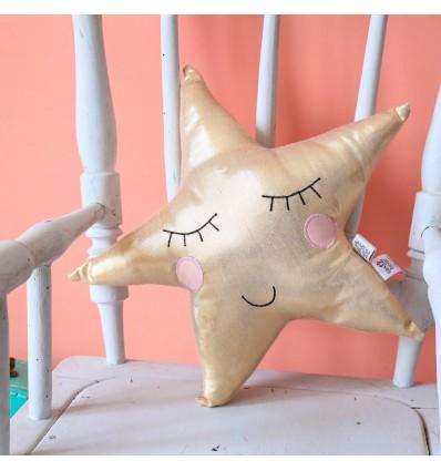 Coussin étoile doré
